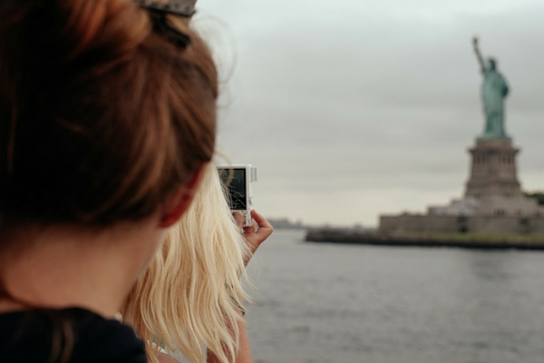 Taking a photo of the Statue of Liberty in New York